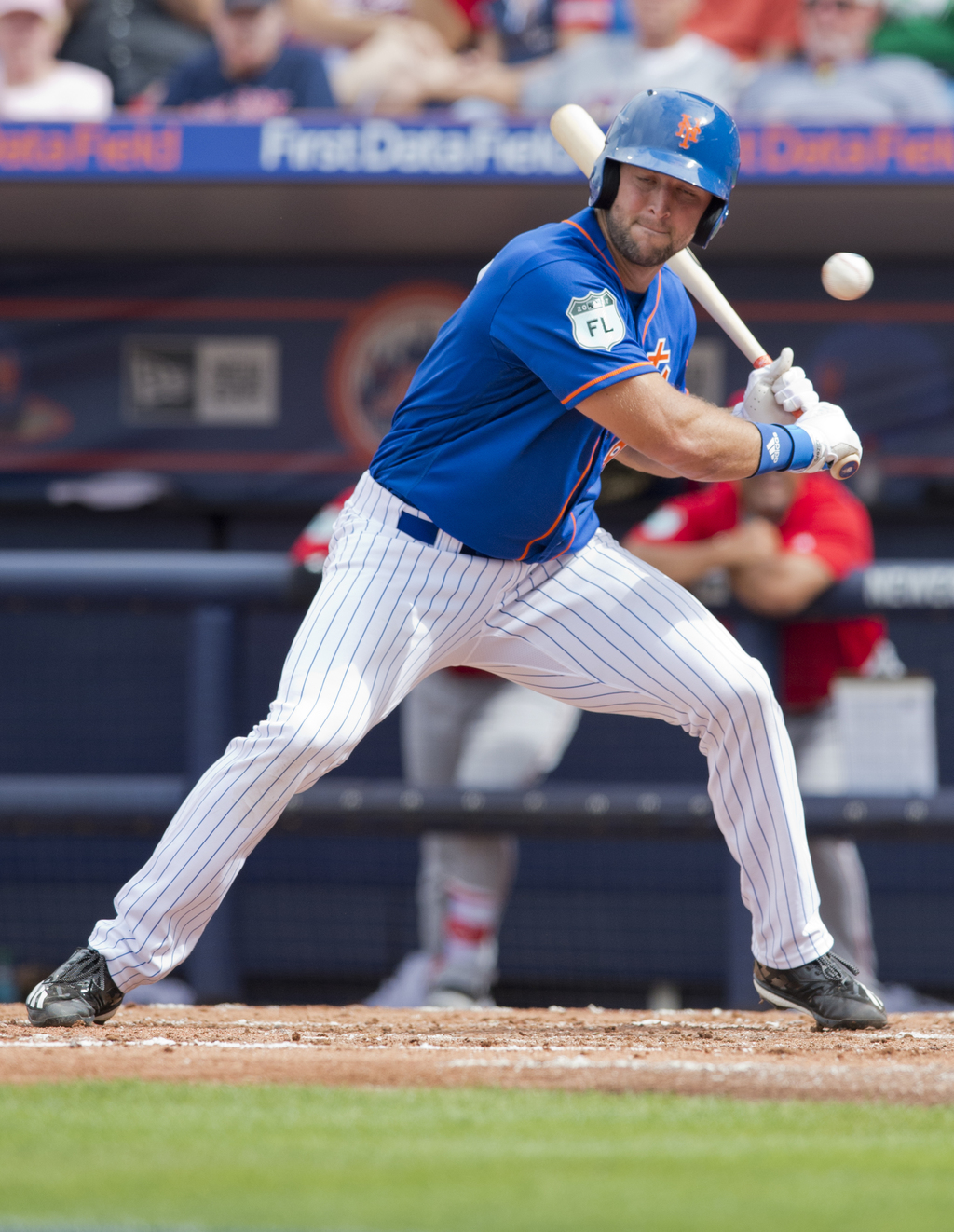 New York Mets designated hitter Tim Tebow lets a pitch go by during his second at-bat in the team's spring training baseball game again...