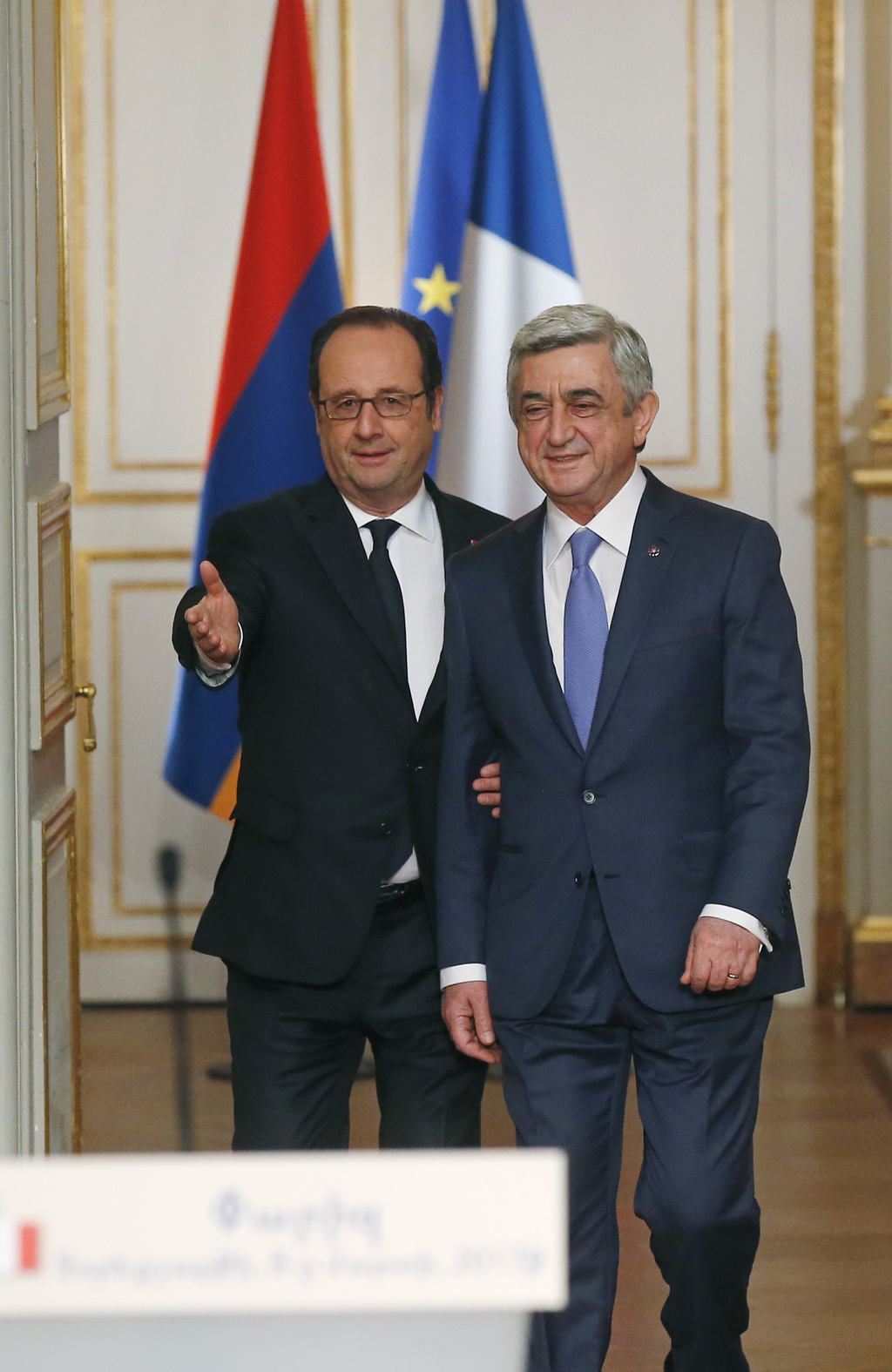 France's President Francois Hollande, left, and Armenia's President Serge Sarkissian arrive for a joint media conference at the Elysee ...