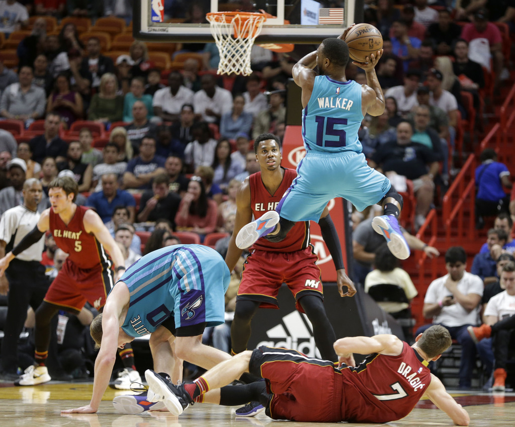 Charlotte Hornets guard Kemba Walker (15) prepares to pass against the Miami Heat in the second half of an NBA basketball game, Wednesd...