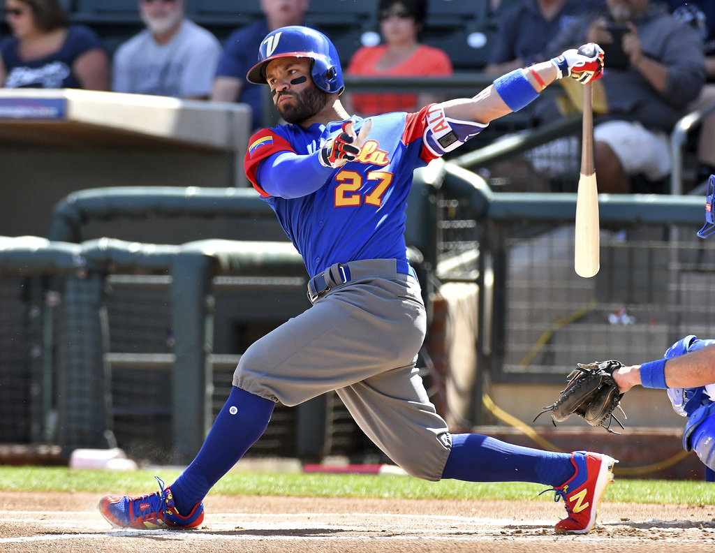 Venezuela's Jose Altuve bats against the Kansas City Royals during a spring training baseball game Wednesday, March 8, 2017, in Surpris...