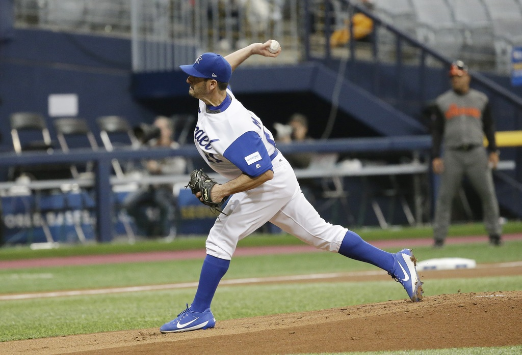 Israel's starting pitcher Jason Marquis throws against Netherlands during the first inning of their first round game of the World Baseb...