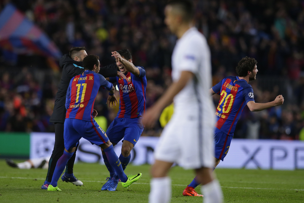 Barcelona's Neymar, Luis Suarez and Sergi Roberto celebrate with team mates at the end of the Champions League round of 16, second leg ...