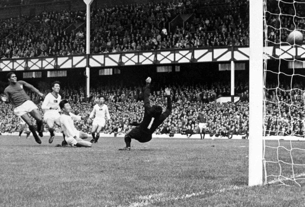 FILE - In this July 23, 1966 file photo, Portugal's Eusebio, left, scores one of his four goals during the World Cup quarterfinal match...