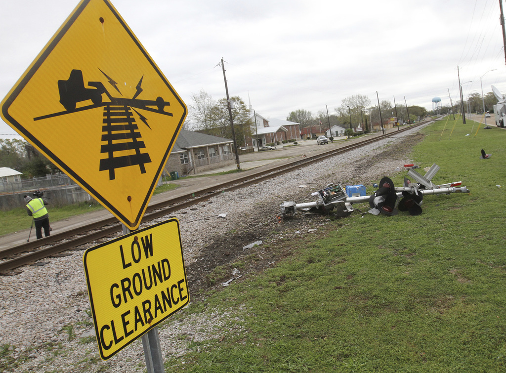 Debris from the railroad crossing signal litters the north side of the railroad tracks on Wednesday, March 8, 2017,  in Biloxi, Miss., ...