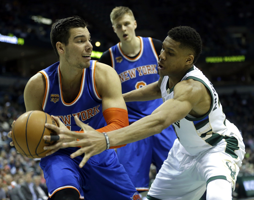 New York Knicks' Willy Hernangomez, left, secures a rebound against Milwaukee Bucks' Giannis Antetokounmpo, right, during the second ha...
