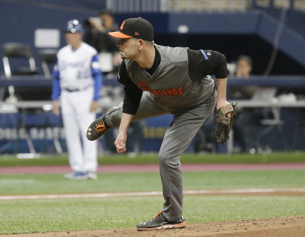 Netherlands's pitcher Robbie Cordemans throws against Israel during the third inning of their first round game of the World Baseball Cl...