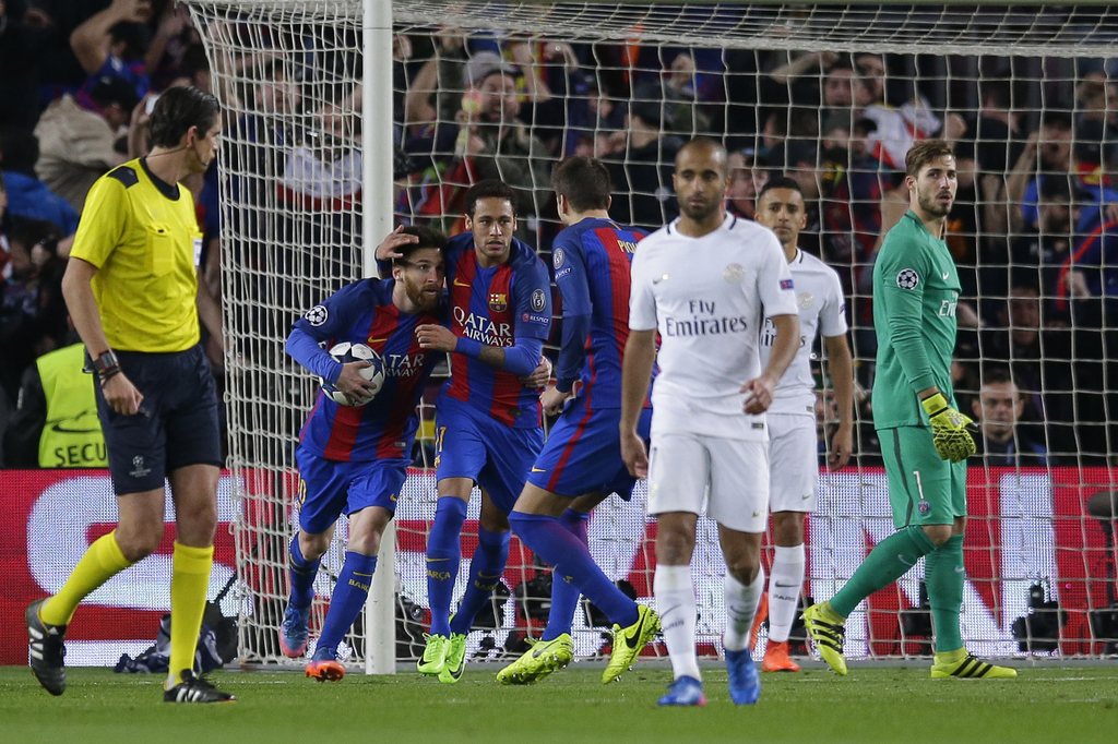 Barcelona's Lionel Messi, left, celebrates scoring his side's 2nd goal from a penalty during the Champions League round of 16, second l...