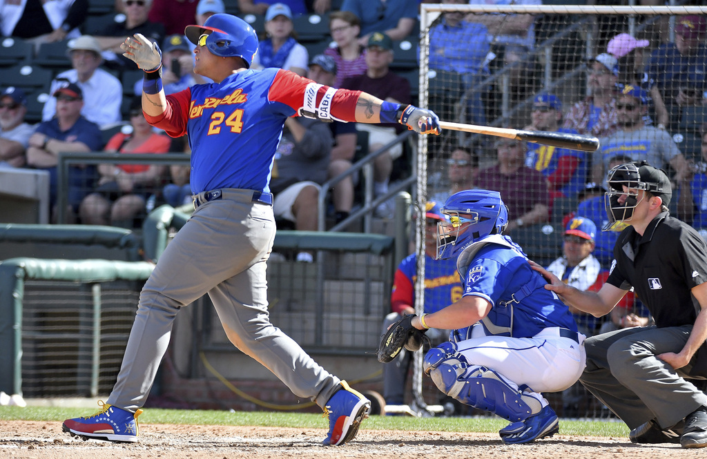 Venezuela's Miguel Cabrera follows through on a solo home run during a spring training baseball game against the Kansas City Royals, We...