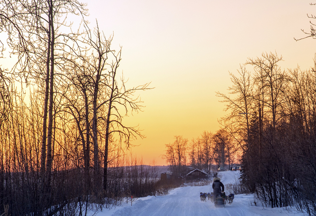 In this image taken Tuesday, March 7, 2017, and provided by the Iditarod Trail Committee, the sun sets as veteran musher Nicolas Petit ...