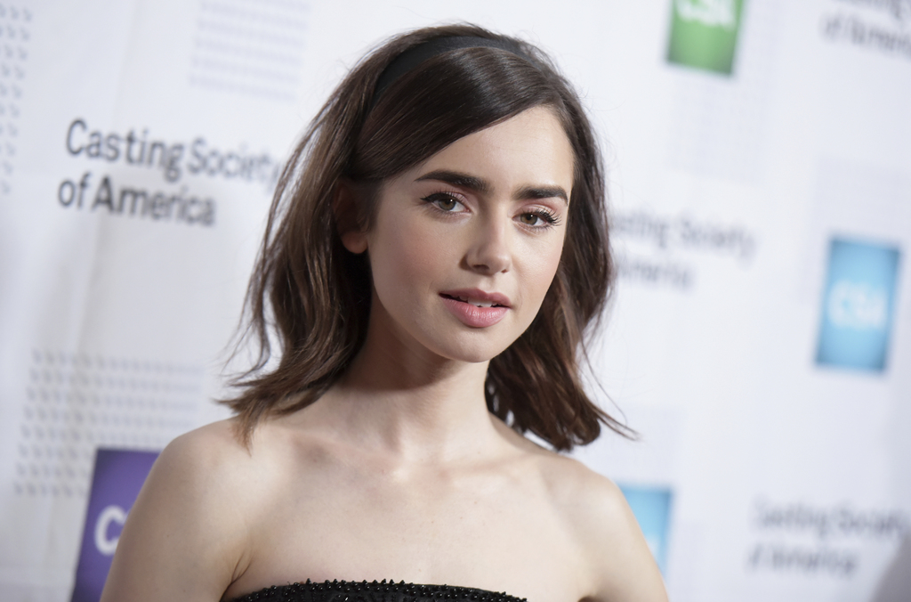 FILE - In this Jan. 19, 2017, file photo, Lily Collins arrives at the 32nd annual Artios Awards at the Beverly Hilton Hotel in Beverly ...