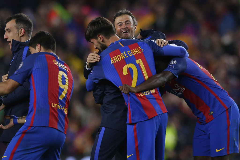 Barcelona's head coach Luis Enrique celebrates with some of his players at the end of the Champions League round of 16, second leg socc...