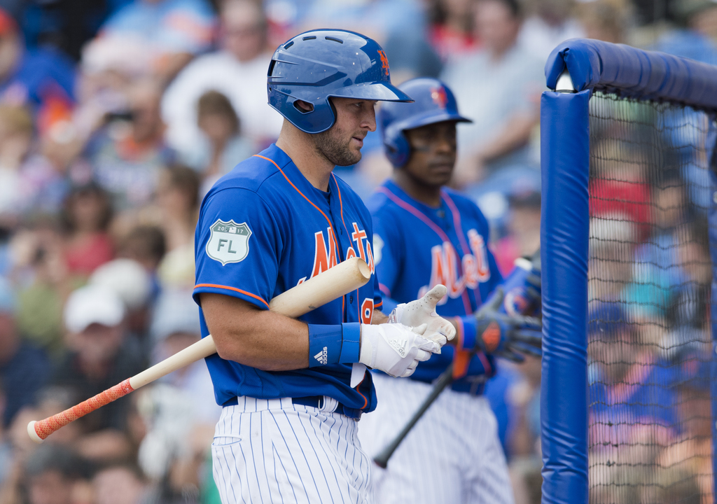 New York Mets designated hitter Tim Tebow walks back to the dugout during a spring training baseball game against the Boston Red Sox in...