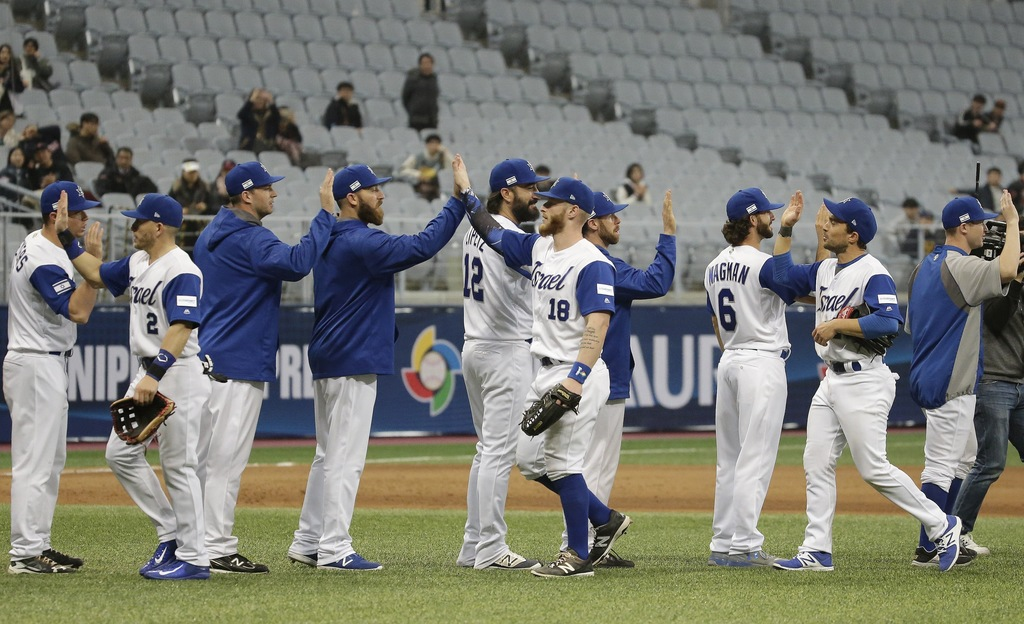 Israeli team celebrate their victory against Netherlands after the first round game of the World Baseball Classic at Gocheok Sky Dome i...