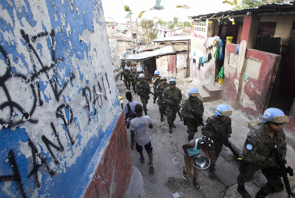 In this Feb. 22, 2017 photo, U.N. peacekeepers from Brazil patrol the Cite Soleil slum in Port-au-Prince, Haiti. They faced no greater ...