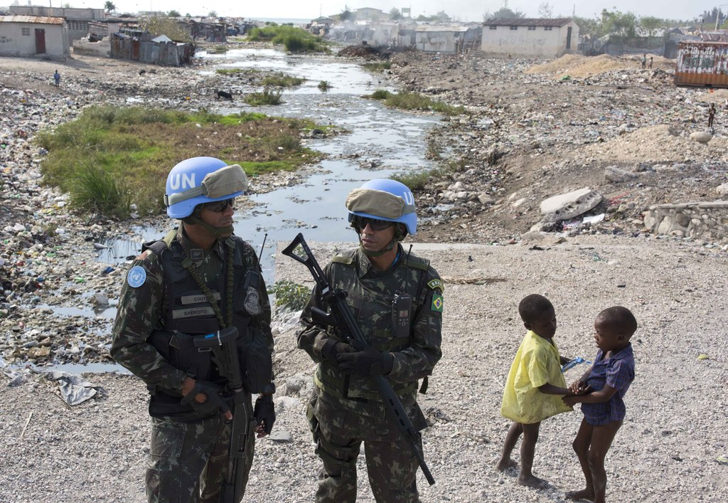 In this Feb. 22, 2017 photo, U.N. peacekeepers from Brazil patrol in the Cite Soleil slum, in Port-au-Prince, Haiti. It took U.N. troop...