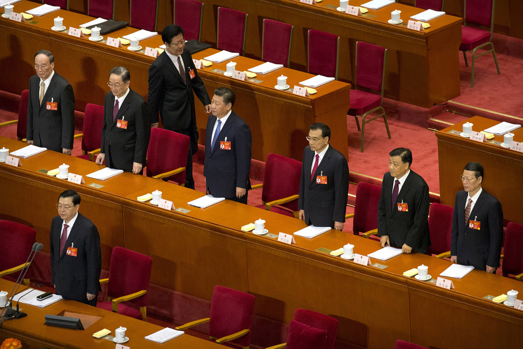 FILE - In this Sunday, March 5, 2017 file photo, members of the Politburo Standing Committee, from left, Wang Qishan, Yu Zhengsheng, Pr...