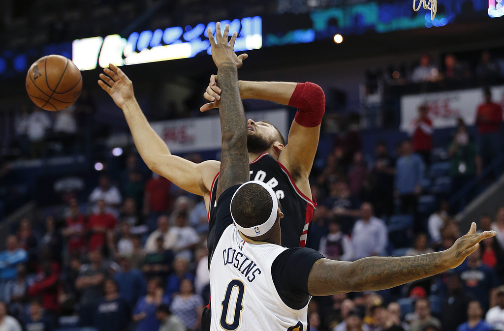 Toronto Raptors center Jonas Valanciunas (17) loses the ball as he goes to the basket against New Orleans Pelicans forward DeMarcus Cou...