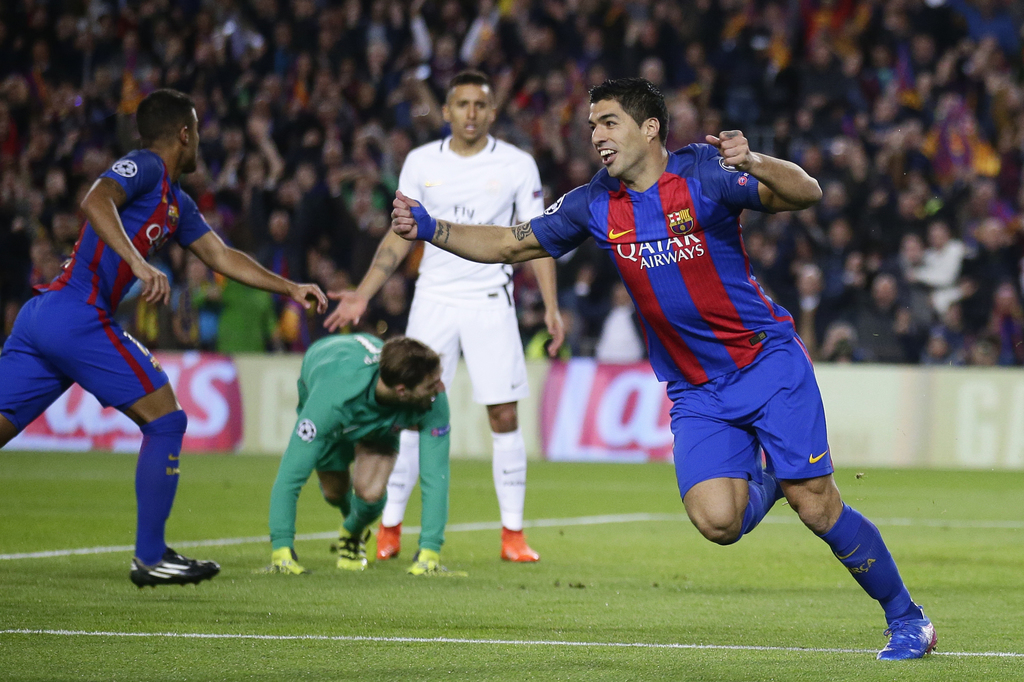 Barcelona's Luis Suarez celebrates scoring the opening goal during the Champion's League round of 16, second leg soccer match between F...