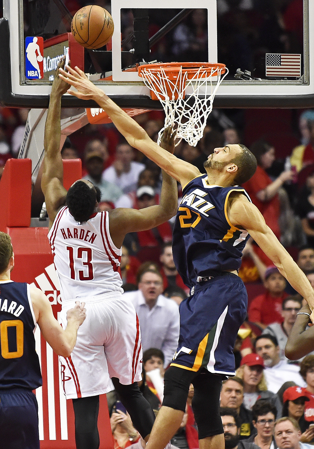 Houston Rockets guard James Harden (13) shoots as Utah Jazz center Rudy Gobert defends in the second half of an NBA basketball game, We...