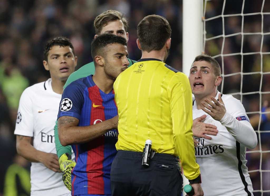 PSG's Marco Verratti, right, argues with the referee Deniz Ayetekin during the Champions League round of 16, second leg soccer match be...
