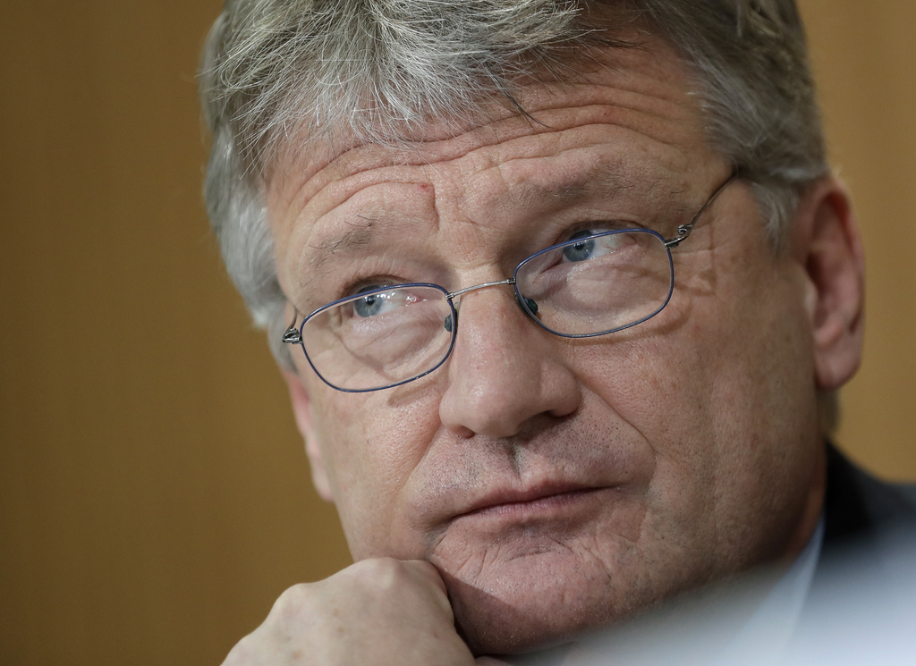 AfD co-chairman Joerg Meuthen attends a press conference of the 'Alternative for Germany' party in Berlin, Germany, Thursday, March 9, ...