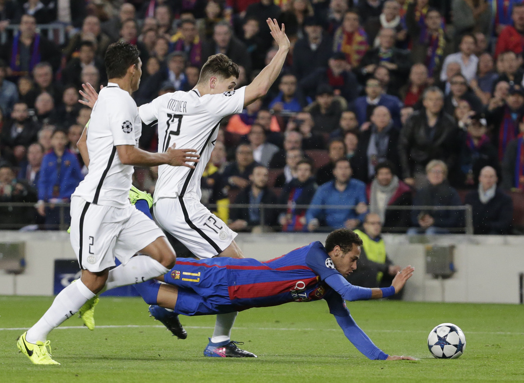 Barcelona's Neymar, right, falls flanked by PSG's Thomas Meunier during the Champions League round of 16, second leg soccer match betwe...