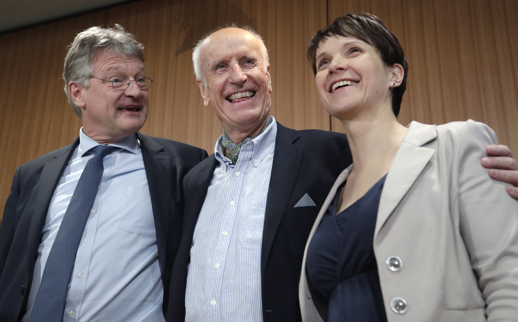 From left, AfD co-chairman Joerg Meuthen, the member of the party board Albrecht Glaser and AfD chairwomen Frauke Petry, pose for the m...