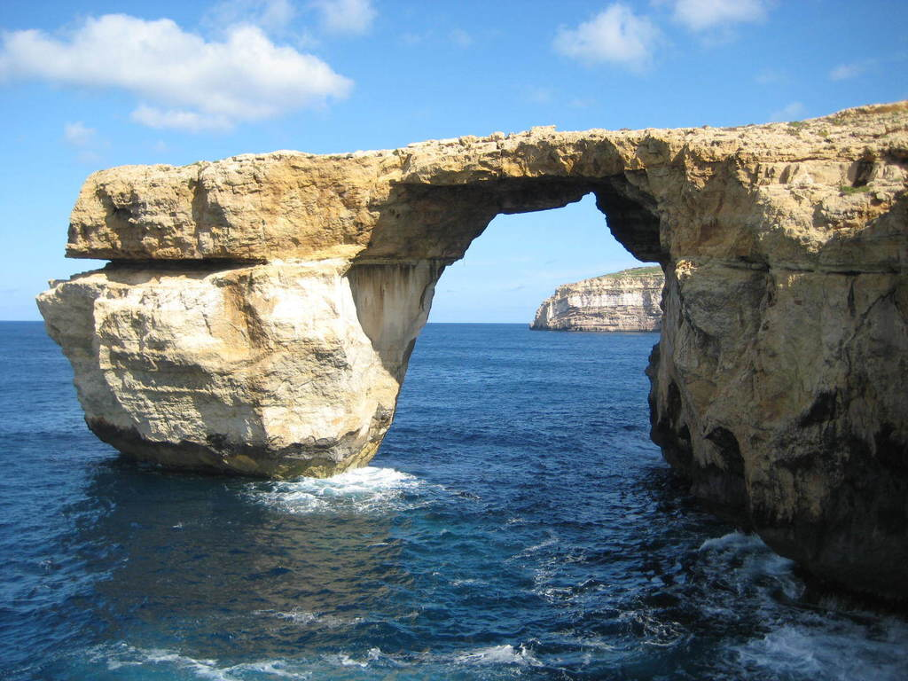 This is a April 2014 image of the landmark the Azure Window located just off Malta.  The natural rock arch jutting off the Maltese isla...