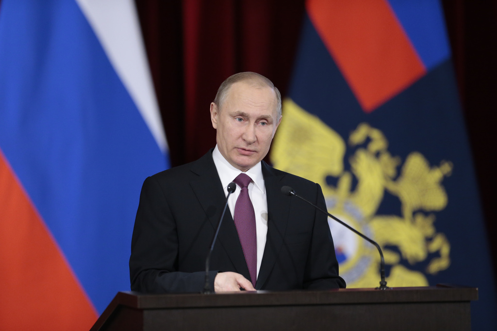 Russian President Vladimir Putin addresses the annual meeting of Russian Interior Ministry in Moscow, Russia on Thursday, March 9, 2017...