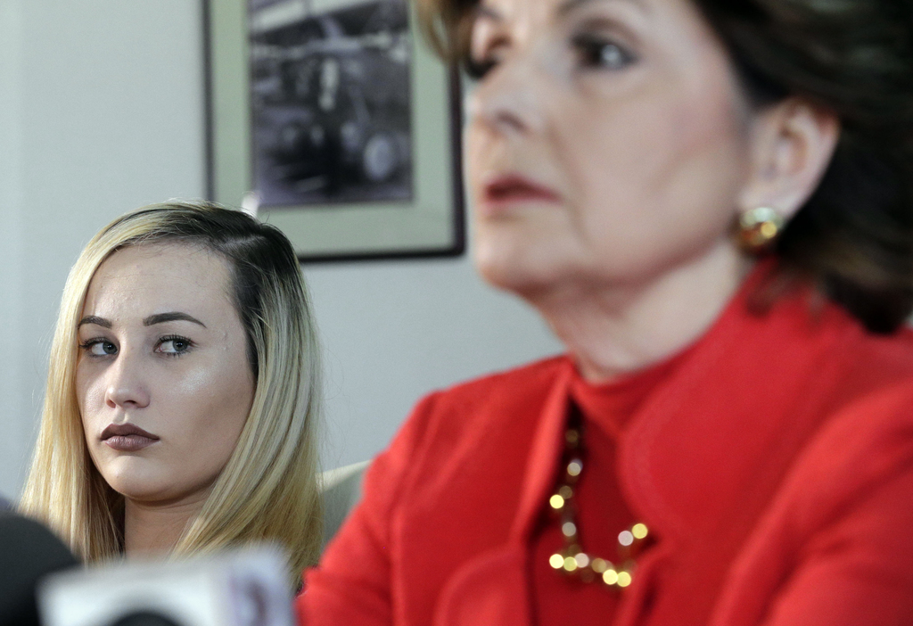 Active-duty Marine Marisa Woytek, left, and attorney Gloria Allred announce that photos of her and another former female Marine were se...