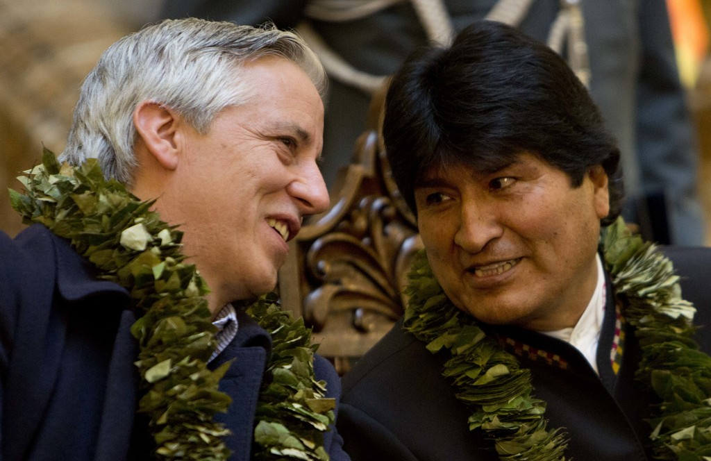 Bolivia's Vice President Alvaro Garcia, left, and President Evo Morales, speak during the signing of a new coca law at the presidential...