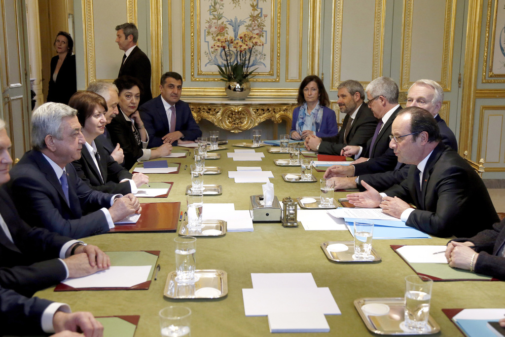 Armenia's President Serge Sarkissian, left, and France's President Francois Hollande meets at the Elysee Palace, Wednesday, March 8, 20...