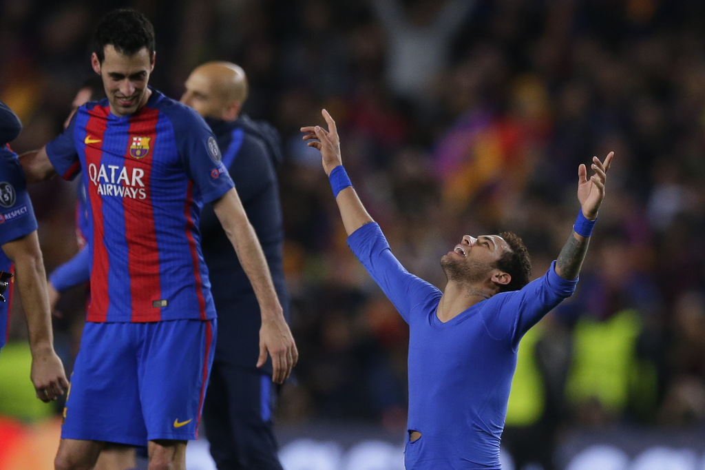 Barcelona's Neymar, right, celebrates with Barcelona's Sergio Busquets at the end of the Champions League round of 16, second leg socce...