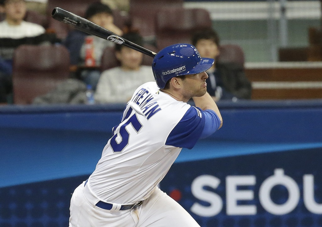 Israel's Nate Freiman hits an RBI single against Netherlands' starting pitcher Robbie Cordemans during the first inning of their first ...