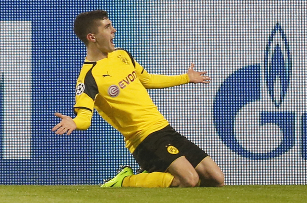 Dortmund's Christian Pulisic celebrates after scoring his side's second goal during the Champions League round of 16, second leg, socce...