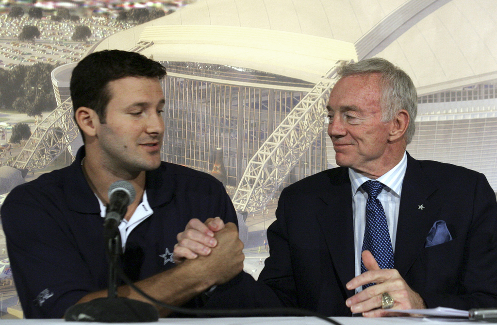 FILE - In this Oct. 30, 2007, file photo, Dallas Cowboys quarterback Tony Romo, left, shakes hands with team owner Jerry Jones during a...