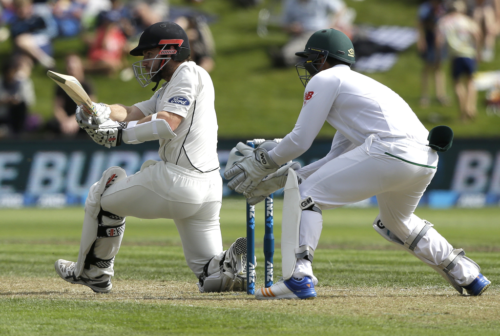 New Zealand's Kane Williamson plays a sweep shot during the first cricket test against South Africa at University Oval, Dunedin, New Ze...
