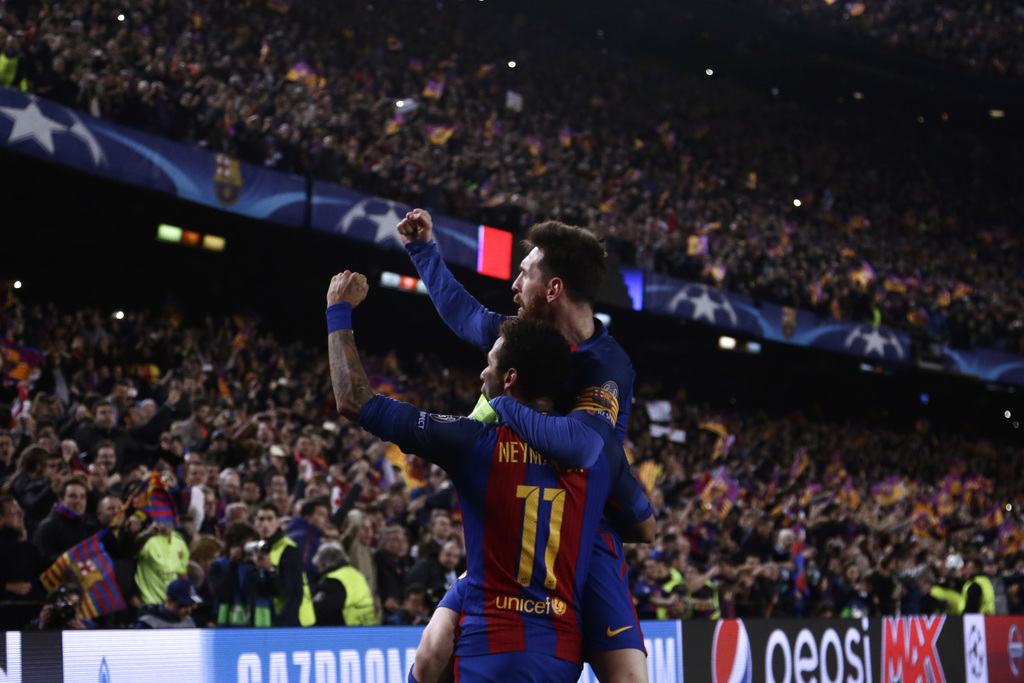 Barcelona's Lionel Messi celebrates with Neymar their victory during the Champion League round of 16, second leg soccer match against P...