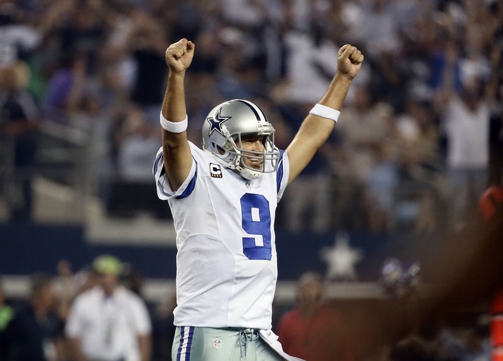 FILE - In this Sept. 28, 2014, file photo, Dallas Cowboys' Tony Romo celebrates a touchdown run by DeMarco Murray during the second hal...