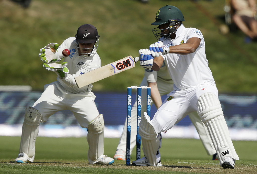 South Africa's Vernon Philander plays at the ball as New Zealand's BJ Watling attempts to catch it during the first cricket test at Uni...