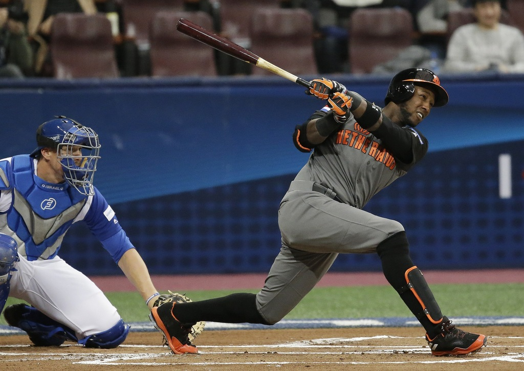 Netherlands' Jurickson Profar hits a single against Israel's starting pitcher Jason Marquis during the first inning of their first roun...
