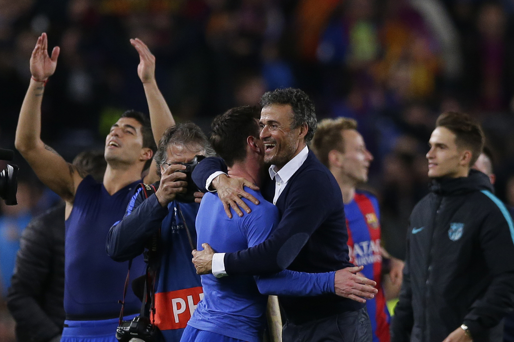 Barcelona's head coach Luis Enrique celebrates with Lionel Messi at the end of the Champions League round of 16, second leg soccer matc...