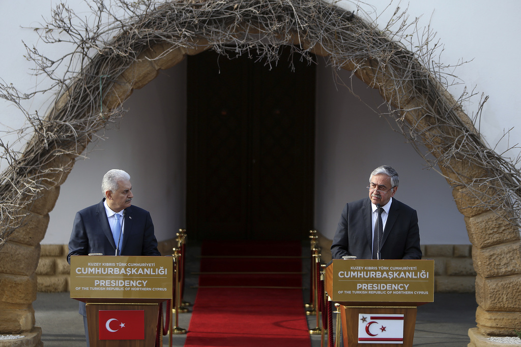 Turkey's Prime Minister Binali Yildirim, left, and Turkish Cypriot leader Mustafa Akinci, speak to the media during a press conference ...