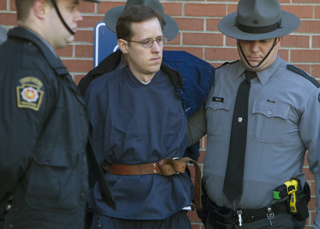 In this Jan. 5, 2015 photo, Eric Frein, center, is escorted out of the Pike County Courthouse after his preliminary hearing in Milford,...