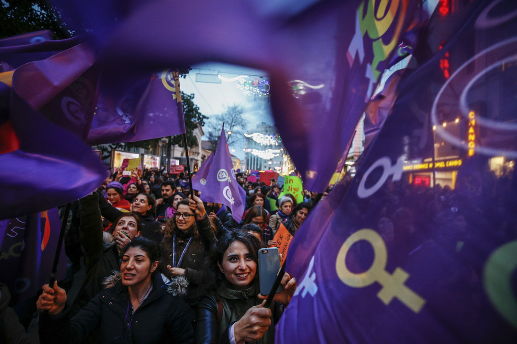 People walk during a protest marking the International Women's Day, in central Istanbul's Istiklal Avenue, Wednesday, March 8, 2017. Or...
