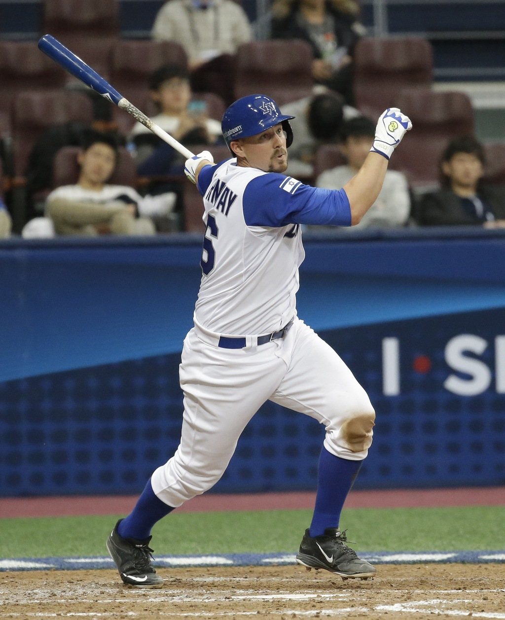 Israel's Ryan Lavarnway hits a single against Netherlands' pitcher Orlando Yntema during the 5th inning of their first round game of th...