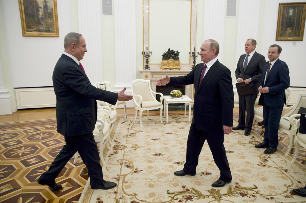 Russian President Vladimir Putin, right, shakes hands with Israeli Prime Minister Benjamin Netanyahu in Moscow, Russia on Thursday, Mar...
