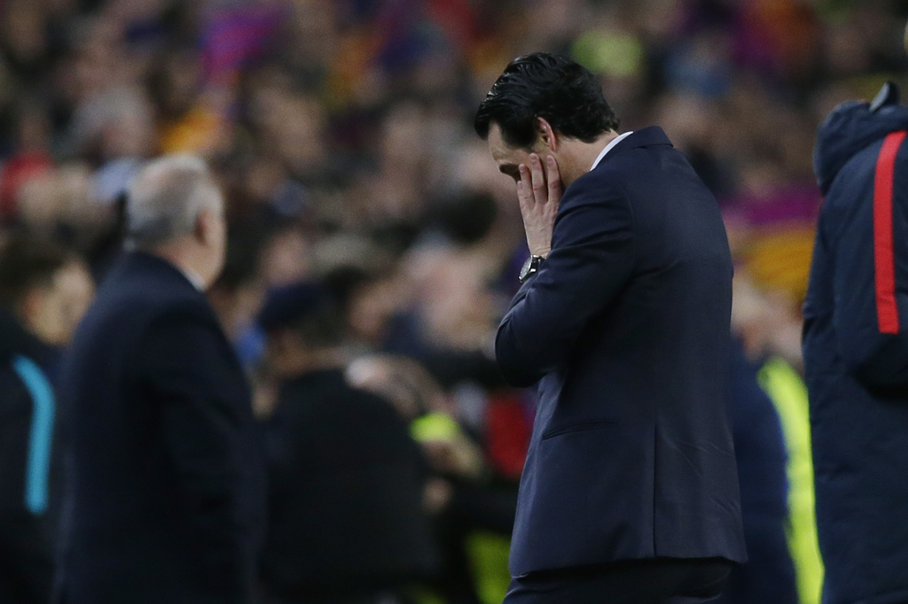 PSG head coach Unai Emery reacts at the end of the Champions League round of 16, second leg soccer match between FC Barcelona and Paris...