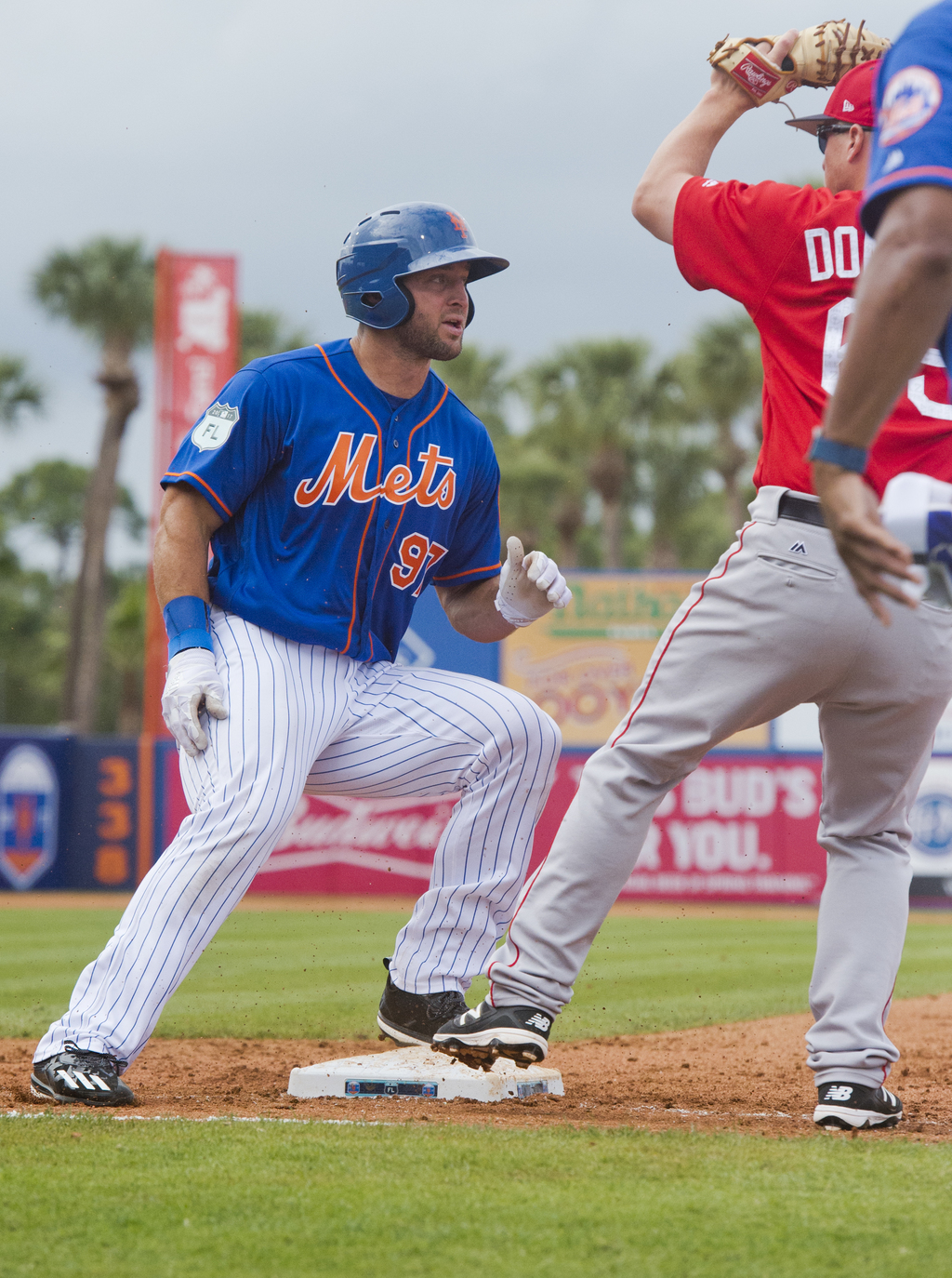 Tim Tebow doubled off first base after a line drive during a spring training baseball game against the Boston Red Sox in the sixth inni...
