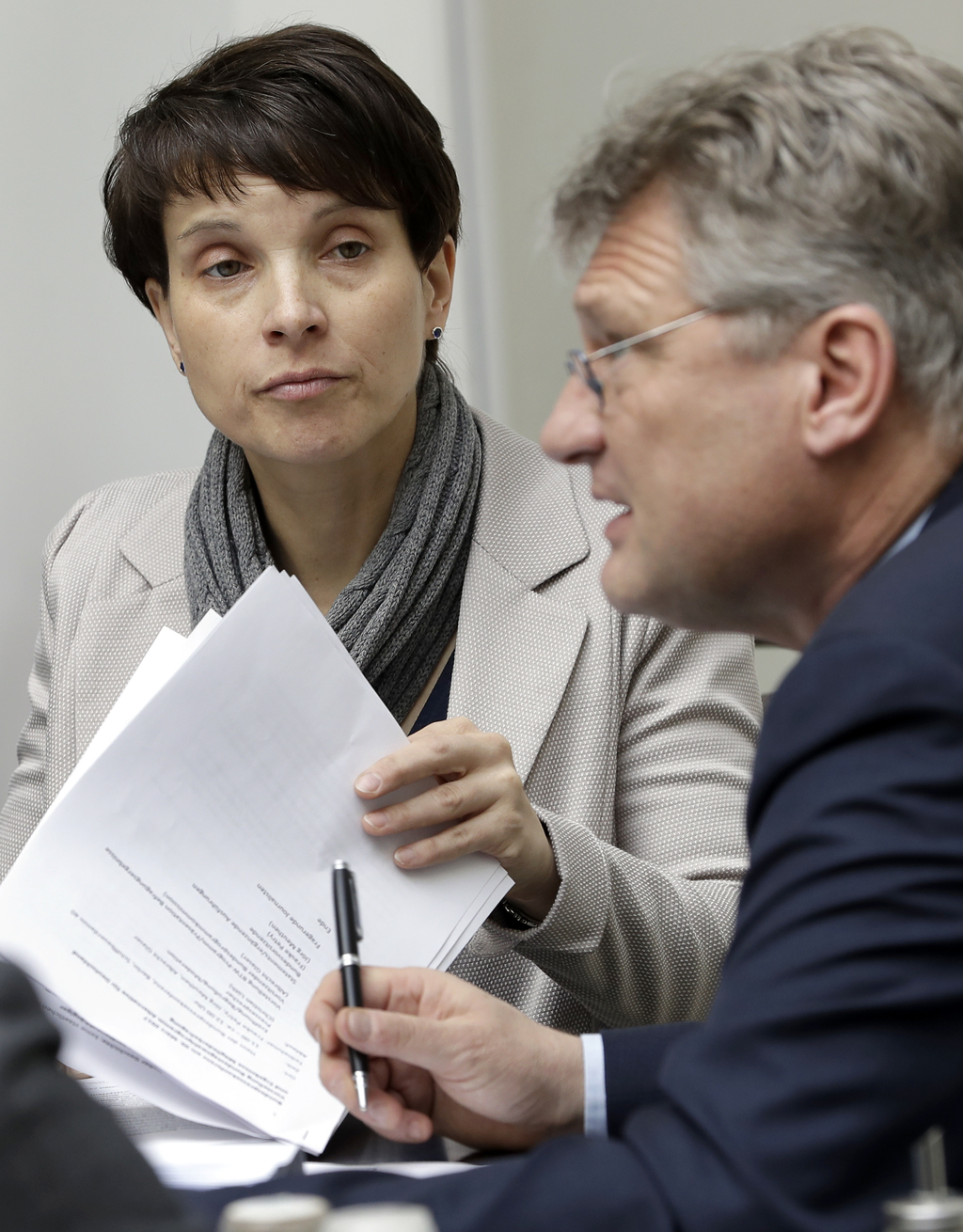 AfD co-chairman Joerg Meuthen, right, and AfD chairwomen Frauke Petry, left, talk prior to a press conference of the populist  'Alterna...